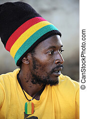 Rastafarian - portrait of young rasta man in traditional...