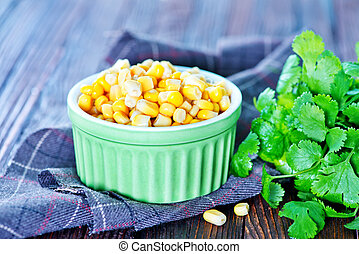 sweet corn in bowl and on a table