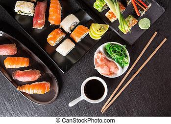 Japanese seafood sushi set on black stone background