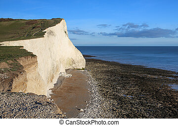 Chalky white cliffs at the South Downs National Park in...