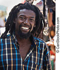 Rastafarian - portrait of young rasta man in the flea market