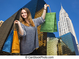 Shopping in New York City Beautiful young woman with...