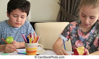 Schoolchildren draws a picture - Little girl and boy drawing...