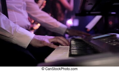 Man playing on synthesizer - Close-up of hands playing the...