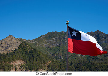 Flag of Chile fluttering in the wind on a ship anchored in...