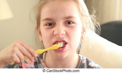 Cute little girl brushing teeth.