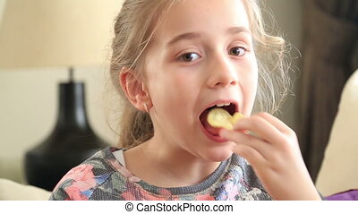 Little girl eating potato chip
