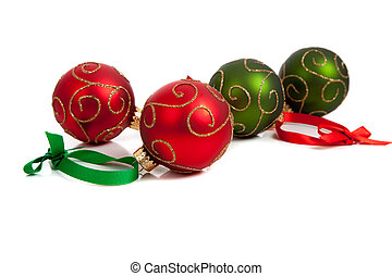 Red and Green Christmas ornaments with ribbon on white - A...