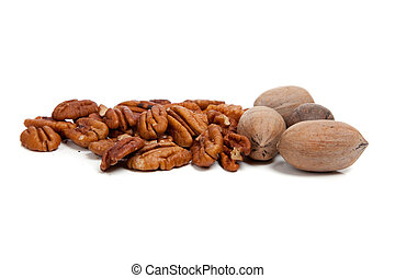 Whole and halved pecans on white - whole and shelled pecans...