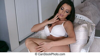 Woman in White Underwear Relaxing on a Chair - Close up...