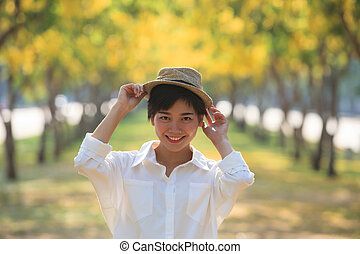 portrait of beautiful asian woman toothy smiling face...