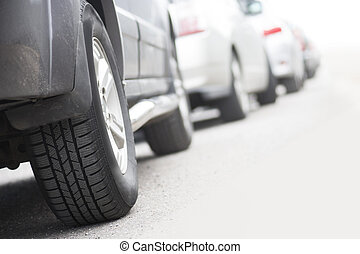 Traffic jam - Low angle view of tire of car in traffic jam