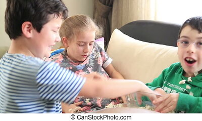 Popcorn war - Laughing friends in living room playing...