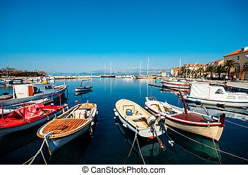 Marine with boats in the city Supetar on Brac island,...