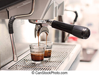 Espresso coffee machine, Coffee is pouring in a glass of...