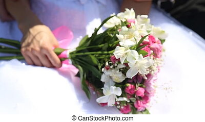 bridal bouquet of flowers in hands of the bride