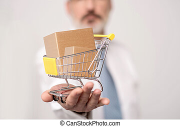 Make your purchases online - Executive showing mini shopping...