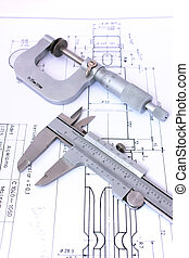 Micrometer and caliper on blueprint vertical Shallow depth...