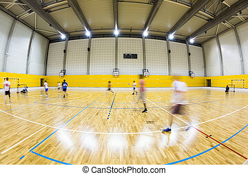 interior of a modern multifunctional gymnasium with young...