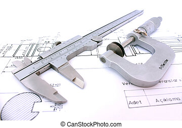 Caliper and Micrometer on blueprint horizontal close up