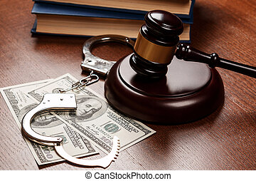 Gavel and money on wooden table