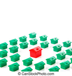 Small toy houses on white background