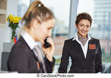 Hotel workers on reception - female receptionist workers...