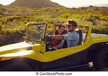 Happy young couple on a road trip - Portrait of happy young...