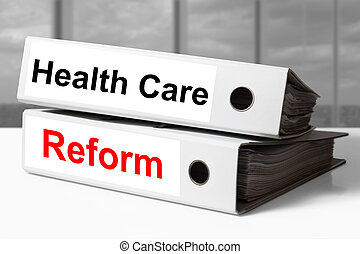 white office binders healthcare reform - stack of white...