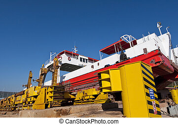 Repairing ferry in shipyard - Repairing old ferry in...