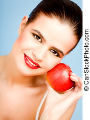 Health & Beauty - Young beautiful woman with red apple.
