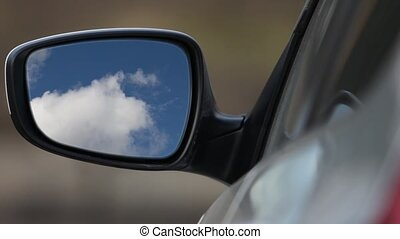 Rear view mirror reflecting sky - Looking Car rear-view...