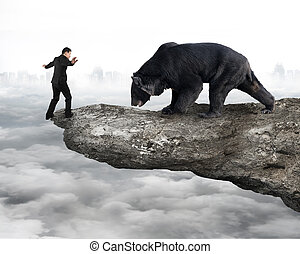 Businessman against black bear balancing on cliff with cloudy sk