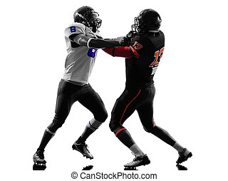 two american football players on scrimmage holding...