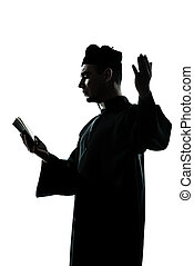 man priest silhouette reading bible - one man priest reading...