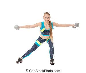 Smiling female athlete exercising with dumbbells