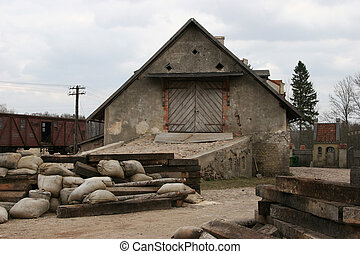 Old freight house next to the railway at cinema town in...