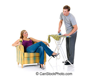 Household, ironing - Young bossy woman in sofa, man ironing...