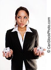 Confused businesswoman holding playcubes isolated on white