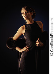 evening dress - Glamorous young woman wearing black evening...
