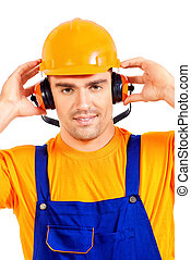 earmuffs - Industrial worker wearing protective helmet and...