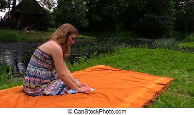 pregnant woman paper ship - Pregnant woman sit on plaid near...