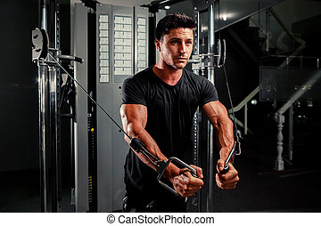handsome man work out in gym - handsome bodybuilder works...