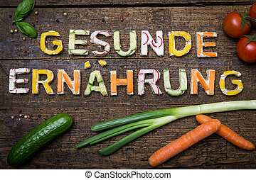 letters of vegetable canapes build the text gesunde...