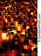 Candles - Many candles burning at a cemetery on All Souls\'...