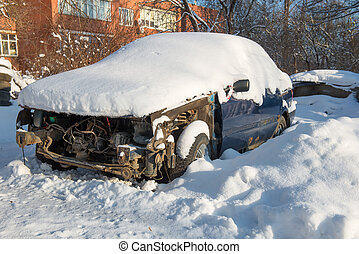 Broken and shattered car is worth in the snow