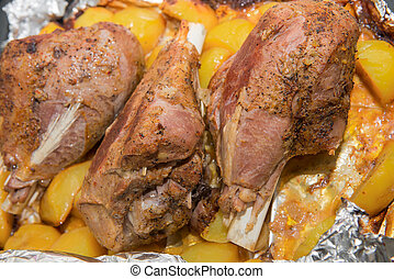 Dinner with baked in foil thigh turkey and potatoes