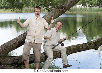 The father with the son on fishing, shows the size of fish