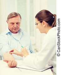 female doctor doing injection to old man - healthcare,...