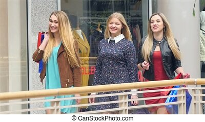 Girls go along and shop talk at the same time, shopping...